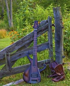 ARTISAN SHOP custom bass with farm fence and  cowboy boots. Custom version of Avandaro body style. Alder body with a jatoba neck and macassar ebony fretboard. Features include an integrated thumb rest, hand carved volutes, and a half fretted neck/ half lined fretless 5 string.