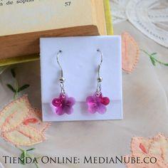 $28000 - Flores fucsia en cristal swarowsky  | Media Nube