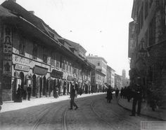 Krakowska street, with ypical rounded entrances to the shops. Kazimierz Town Hall in the background. Narrow-gauge tram rails in the street. Photo F. National Archives in Krakow Krakow Poland, Historical Images, Town Hall, Planet Earth, Art And Architecture, Old Photos, Entrance, Old Things, Street View
