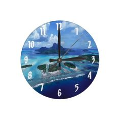 Unique, trendy, fashionable and decorative beach and tropical summer themed wall clock. With pretty painting of the exotic Bora Bora lagoon and islands. Beautiful use of blue and ocean turquoise colors. Cute and fun gift for mom's or dad's birthday, Mother's or Father's day, or Christmas. Great for decorating the master or kid's bedroom, nursery, man cave, dining, living or family room, boat or yacht, beach or vacation house, cottage or cabin, or office with.