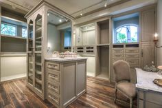 Her elegant and spacious closet with vanity.  Lights inside each closet compartment to light clothes.