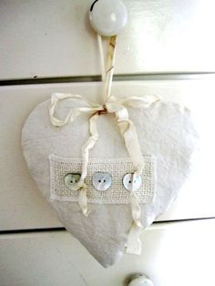 Heart of linen with buttons and bows in creamy white