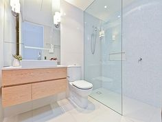 like the vanity, colour and the space where the toilet is could be the knobs for clothes
