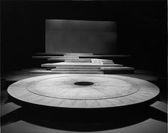 John Ferguson – Set for The Oresteia of Aeschylus, directed by Robert Lowell, NAC Theatre, 1983 Turn tables and stone yards Stage Set Design, Set Design Theatre, Complete Works Of Shakespeare, Bühnen Design, Theater, Exhibition, Scenic Design, Stage Lighting, Lighting Design