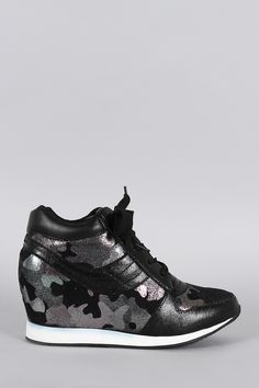 Description This lace up sneaker was designed with a combination of a sold color and a glittered camouflage pattern. Designed with a hidden wedge and a cushioned high top. Material: Leatherette and Fa