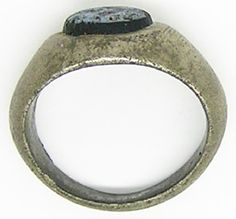 This is an ancient Roman silver intaglio ring, dating to the 2nd - 3rd century A.D. The intaglio is made from blue and black glass, cast in the form of a costly 'nicolo' Arabian onyx. the design is quite hard to make out, but is in the form of a stylized pair of clasped hands known as a 'dextrarum iunctio' right hands joining. This is a timeless symbol of trust, loyalty and friendship - used also in the marriage ceremony. Such an intaglio ring would have been used to seal letters and…