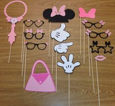 These photo booth props will be a hit at any party. Whats included: 14 pieces... 1 Vanity mirror 1 Minnie Mouse ears with bow 6 pairs of glasses 1 pair of lips 3 Mickey Mouse hands 1 Minnie Mouse bow 1 Minnie Mouse purse These props are made using card stock. The colors and
