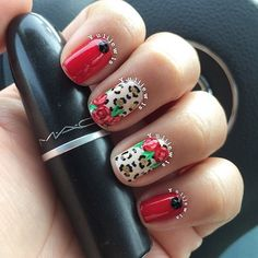 So cute with the red roses on top of the leopard print. I'm such a sucker for rose nails.