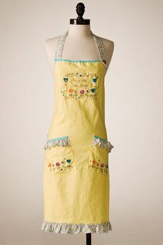 I know this is dorky, but how cute would it be if I put on an old-fashioned (but cute and on-palette) apron for the cake cutting? It would go somewhat with the feel, and it would protect the dress!