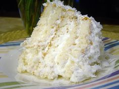 "This is an old recipe ""wet coconut cake"" I don't care how old this recipe is...would you look at this slice of cake??! I want to eat this from the inside out and if my husband wasn't sitting here next to me, I would probably be licking this screen."