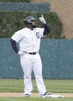 Detroit Tigers Prince Fielder stands at second base pointing up at the snow falling in the 8th inning .