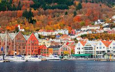 Autumn colours surround the Norwegian city of Bergen and it's old centre, Bryggen - a UNESCO World Heritage site. The city of Bergen was founded in 1070. The area of the present Bryggen constitutes the oldest part of the city.