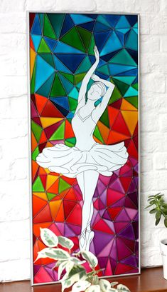 Ballerinas contemporary painting on glass performed in stained glass technique. Original polygonal art Dancer, modern and stylish. This beautiful bright painting with dancing girl may be used as a wall hanging or as a glass panel. It is performed on thick glass with transparent paints