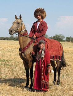 traditional Turkmen tack and attire (horse: Akhal-Teke)