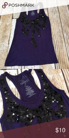 """Miley Cyrus purple tank with sequin bow medium Miley Cyrus purple tank with sequin bow medium   🍥Bundle deals available (I carry various sizes and brands in my closet): 2 items 10% off, 3 items 15% off, 4 items or more 20% off.  🍥No trades, modeling, or lowball offers please. 🍥All reasonable offers accepted only through """"offer"""" button. Please submit offer willing to pay as I prefer to not counteroffer. 🍥I appreciate you all. Happy Poshing! miley cyrus Tops Tank Tops"""