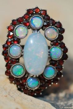 Antique Australian opal and garnet ring from the Victorian Era.