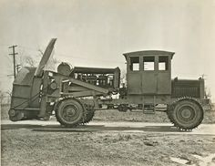 Side view of old snow plow.