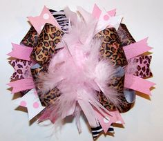 posh diva animal print bow..Oh yeah we are so making this for her.