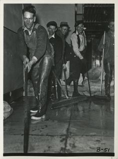 Cincinnati, Ohio, 1937 flood, from the collection of the Cincinnati Bell Historical Archives: Cleaning up at South Exchange. From left to right: Sam Litly, Kelly Pryor, Dick Rinehart, Bryon Roland and William Meier.
