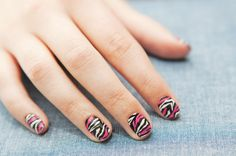 this is an example of how to use a nail strip (like sally hansen's) and then paint on top of it...its the zebra nail strip with hot pink nail polish