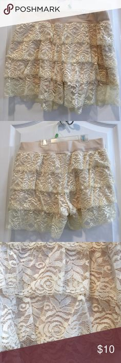 NWOT Lace Shorts. Ivory Lace over tan shorts. Four rows of Lace. Never worn. Self 1 50% polyester 50% cotton. Self2 90% nylon 10% spandex. Hand wash. Waist is 28 inches and it stretches. iris basic Shorts