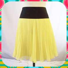 Sunny Yellow Pleated Chiffon Skirt Sz S/M Pretty yellow pleated skirt with black satin around the waist. Layered. Side zip closure. Falls above the knee. No brand or size tag but measures at a Small to Medium for those with a 30 inch waist. Length: 19.5 inches. No flaws. . Skirts A-Line or Full
