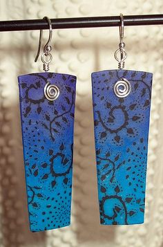 blue batik earrings made with a skinner blend background overlayed with cane slices of a black design packed in translucent clay | by Marla Frankenberg