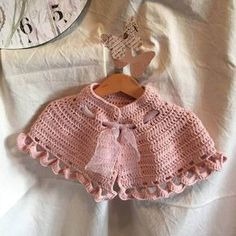 The shawl crochet is designed for an important event for a girl, for their first communion, with this as romantic as it offers the pink color Crochet Baby Cardigan, Baby Girl Crochet, Crochet For Kids, Crochet Shawl, Crochet Yarn, Free Crochet, Crochet Needles, Single Crochet, Crochet Clothes