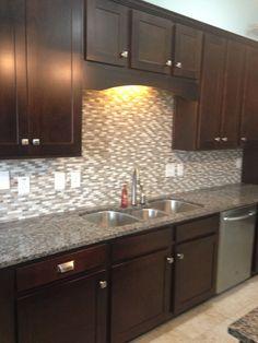 Dark cabinets Caledonia granite, stone tile backsplash