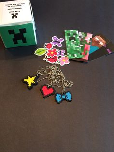 Pixelated necklaces and stickers from Oriental Trading. All inside cupcake boxes with printed labels. Minecraft Birthday Party, Birthday Parties, Cupcake Boxes, Printing Labels, Oriental Trading, Favor Boxes, Bookmarks, Favors, Necklaces