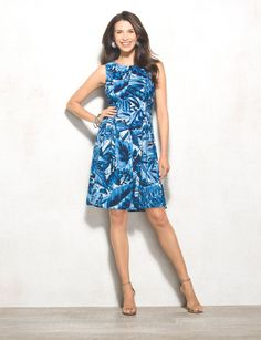 Make a summer statement in something blue. One of our favorite colors to rock during summertime, this cool-hued dress is perfect for pairing with your go-to neutral sandals. Allover blue and white leaf print. Imported.