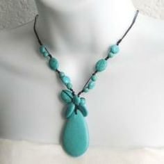 @Overstock.com - Reconstructed Turquoise Teardrop Necklace (Thailand)  - Add a gorgeous look to your favorite outfit with this handmade turquoise necklace from Thailand. The turquoise pendant brings beautiful color to your wardrobe, and a stone button toggle keeps the cotton wax rope securely around your neck.  http://www.overstock.com/Worldstock-Fair-Trade/Reconstructed-Turquoise-Teardrop-Necklace-Thailand/5707962/product.html?CID=214117 $24.99