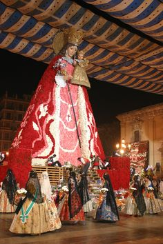 Mare de Deu (Valencian for 'Mother of God') Virgen de los Desamparados (Spanish for 'Virgin of the Forsaken') con el manto de flores. (Building Mary's dress & cape during the offering of flowers) - Las Fallas Festival - Valencia, Spain