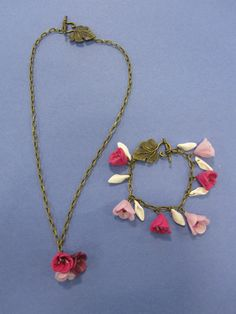 Jasmine's lovely polymer clay flower necklace and matching bracelet on antiqued brass chain and with matching toggles and clasps. Made during the NCFE level 1 Jewellery in a Variety of Media course in December 2014. Everyone made individual pieces, and it is lovely to see creativity literally blossoming in my classes! Well done!