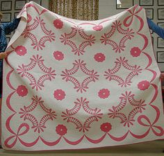 antique/vintage quilt ... I know it's pink and white.  that is what red and white make.  Pink.
