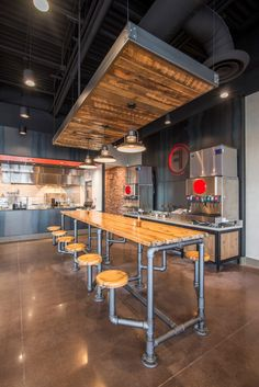 Rustic and Industrial come together in perfect harmony at this fast casual chain, FREEB!RDS with products by TimeWorn Wood.  TimeWorn Wood specializes in handcrafting solid wood table tops for restaurants and bars.   Product shown: Distressed Pine Product ID: DP-NT  www.mntimeworn.com  #pipetablebase #rusticdiningtable #timewornwood