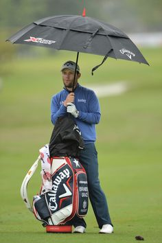 Branden Grace of South Africa ponders a shot during the weather delayed first round of The Nelson Mandela Championship at Mount Edgecombe Country Club on December 12, 2013 in Durban, South Africa.