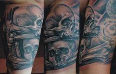 Skull and bones tattoo by Miro Pridal
