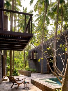 Photo Caption: The Palmyra House, south of Alibag, was designed by Bijoy Jain as two discrete structures in concrete and wood—the latter most prominently visible in the louvred walls that blur the line between the outside and in Indian Architecture, Architecture Details, Studio Mumbai, Louvered Shutters, Teak Flooring, Two Storey House, Cement Walls, Timber Deck, Arquitetura