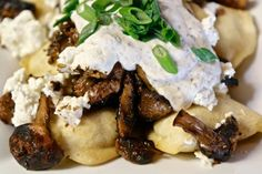 Perogies & Wild Mushrooms: six different types of fungi (portobello, oyster, shitake, button, white truffle oil and black truffle shavings) goat cheese and sour cream! Oyster Mushroom Recipe, Mushroom Recipes, White Truffle, Truffle Oil, Wild Mushrooms, Stuffed Mushrooms, Types Of Fungi, Portobello, Awesome Things