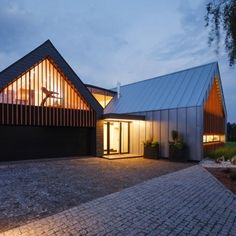Two Barns House: Location: Tychy, Poland Year of Construction: 2014  Architects: RS+  A more stylized and modern take on a barn inspired residential home with large openings and private spaces.