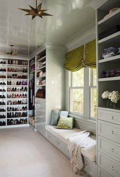 White closet with window seat and antiqued star pendant lamp.