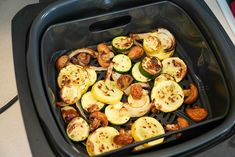 Best air fryer vegetables you will ever make are here! No breading, just seasonings and mixed vegetables cooked to perfection. A healthy side dish fave. #ninjafoodi #airfryer #airfryerrecipes #vegetables #mixedvegetables #ninjafoodirecipes #ninjafoodigrill #mushrooms #zucchini #yellowsquash