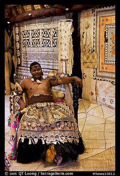 Fiji tribal chief inside vale levu (chief) house. Polynesian Cultural Center, Oahu island, Hawaii, USA (color)