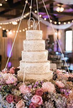 With Houston, Texas, as the backdrop for their wedding, Aaryn and Nick knew they needed a big cake. Whisk Bakery created a dramatic vanilla cake with amaretto filling that was decorated with silver pearls and displayed on a hanging stand.