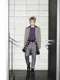 EXO's Baekhyun for Officiel Hommes magazine photoshoot August issue, 2013. Jacket, knit top, and pants by Prada, Knit sweater (around the waist) by Prorsum Burberry, and shoes by Christian Louboutin.