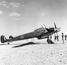"""Captured Messerschmitt Bf 110D """"The Belle of Berlin"""" in British markings on a landing ground in North Africa. This aircraft served with II/ZG76 in Iraq and was captured after crash-landing near Mosul in May 1941. It was used as a communications aircraft and later as a unit 'hack' by No.267 Squadron RAF."""