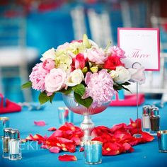 Floral centerpieces in silver urns contained Stargazer lilies, peonies, roses and hydrangeas.