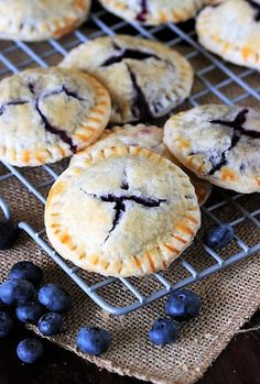 Stuffed full of Mom's homemade fresh blueberry pie filling, Blueberry Pie Cookies are just like eating an adorable mini little blueberry pie. Cookie Pie, Cookie Desserts, Just Desserts, Cookie Recipes, Dessert Recipes, Pie Recipes, Recipies, Mini Blueberry Pies, Blueberry Cookies