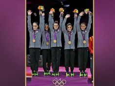 2012 USA Olympic gymnastic team with their gold-Fab 5, way to go!
